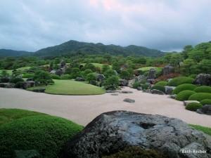 The main garden incorporates background hills