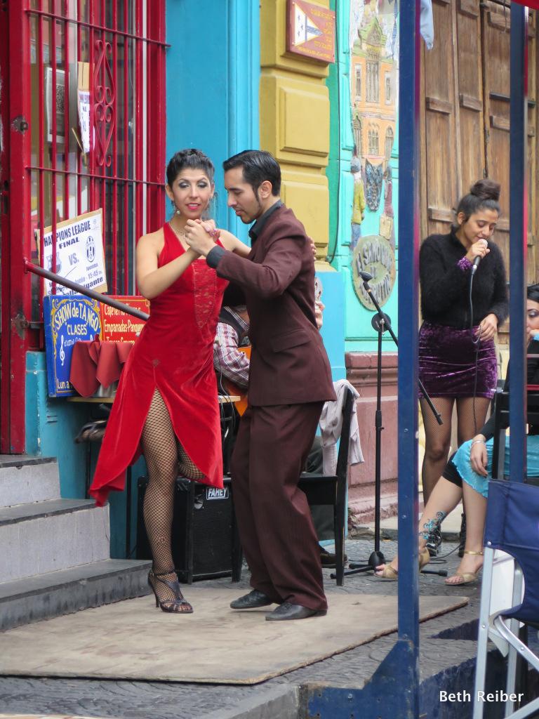 Tango dancers entertain at an outdoor restaurant in La Boca